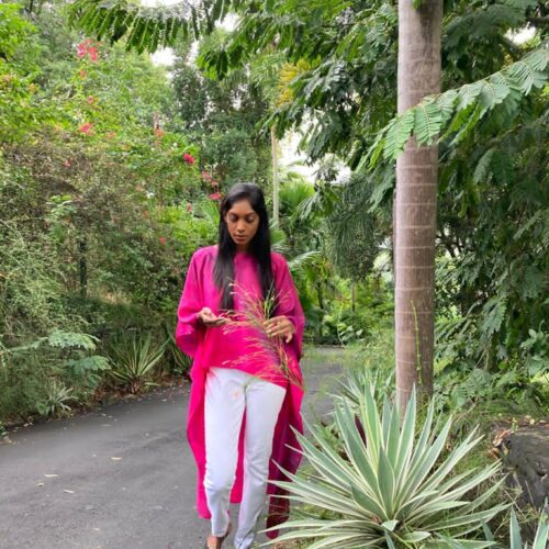 Turn heads in this hot pink and purple hi-low kaftan top